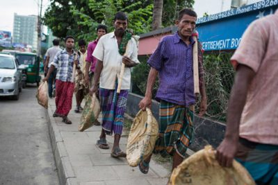 Labourers return home after a days work in Dhaka.