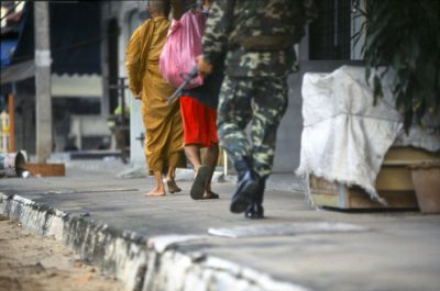 Buddhist-monk-and-soldiers-feet-Pattani-town