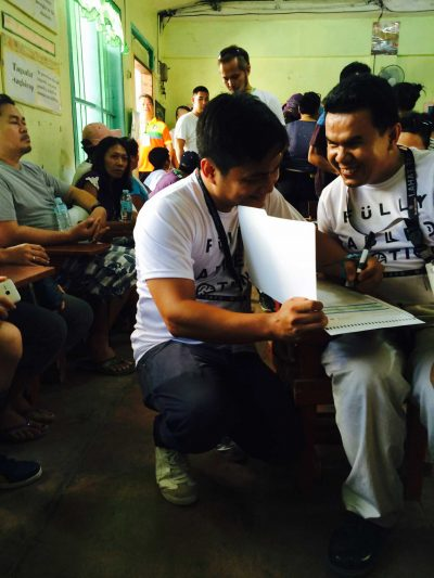 Marvelous Jorda works with an assistant from FAN to cast his vote at Gun-ob Elementary School in Lapulapu City, Cebu on May 9.