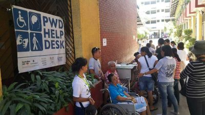 PWDs in line to vote at an Emergency Accessible Polling Place in Abellana National High School in Cebu City.