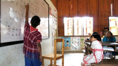 A S'gaw Karen student runs his classmates through a pronunciation drill. Photo/Lukas Winfield