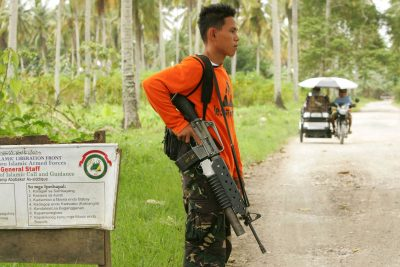 Photo from Mindanao, Philippines: soldier at a checkpoint.