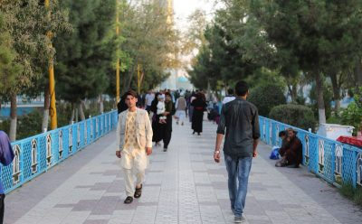 Daily life: Afghans stroll on a walkway in Mazir Sharif City.