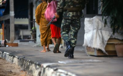 Buddhist monk and soldiers feet Pattani town
