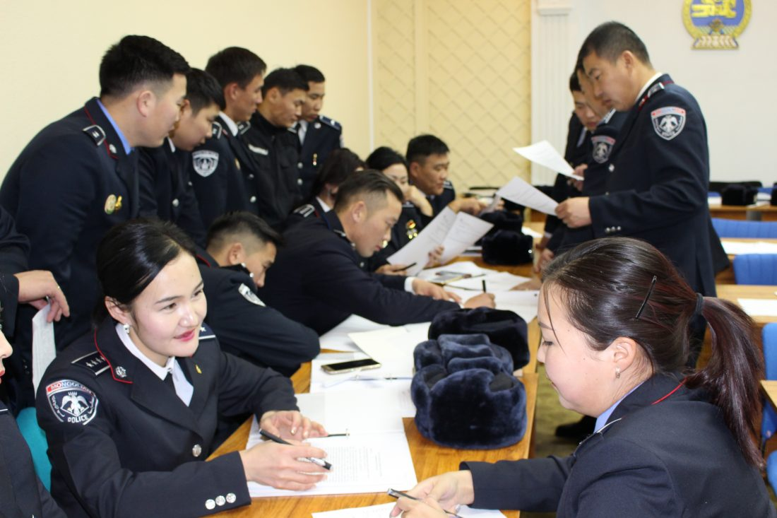 Police and cadets participate in a training session to equip them with the skills and knowledge of how to respond to and manage domestic violence situations.