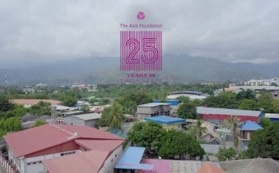 Aerial view of Dili, with Asia Foundation 25 years logo.