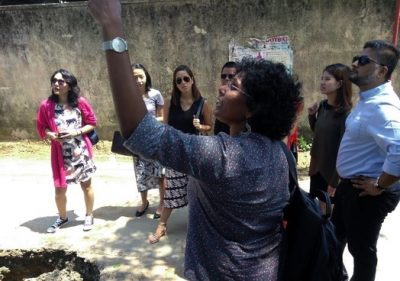 Iromi Perera leads the current cohort of development fellows on an urban governance tour of Colombo during the 2018 Workshop on Asian Development in Sri Lanka.