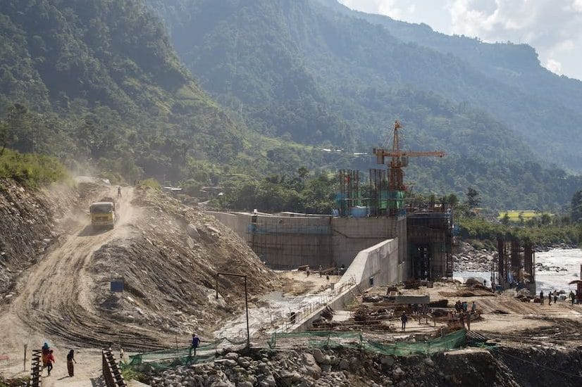construction equipment and half-built structures in Nepal mountains