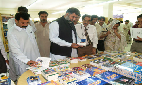 Representatives from different institutions select books at a Books for Asia Book Fair.