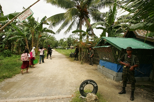 Schoolgirls pass through a border checkpoint of MILF camp in Mindanao. Photo by Karl Grobl.