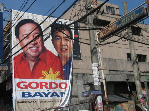 An election campaign poster covers the side of building in Manila.