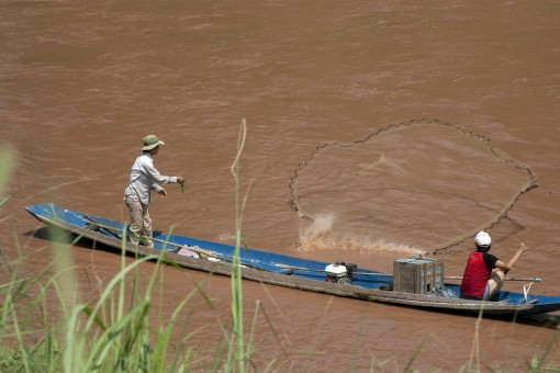 As the country the holds the largest percentage of the Mekong River, Laos relies heavily on the river's steady flow for food supply, such as fishing pictured above as well as electricity and transportation.