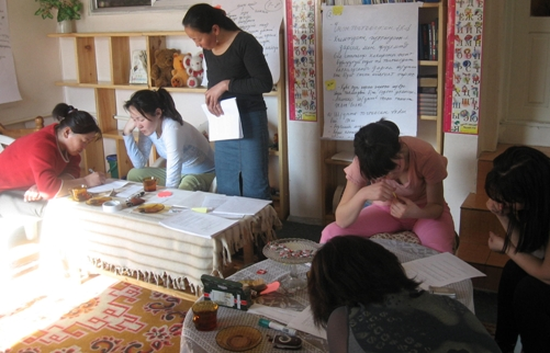 Women who fled to the National Center Against Violence (NCAV) shelter in Ulaanbaatar relax with staff in the shelter's library.