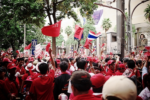 Red shirts protest this week in Bangkok's commercial center. Photo by Flickr user Pittaya, used under a Creative Commons license.