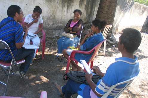 Community members consult legal aid workers in Timor-Leste