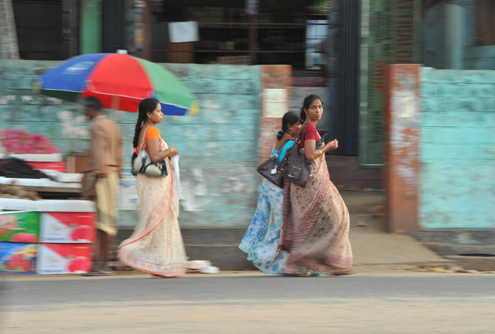 Women walk along in Sri Lanka's capital