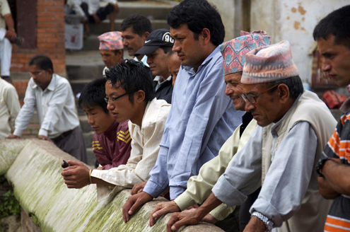 Men gather in Nepal