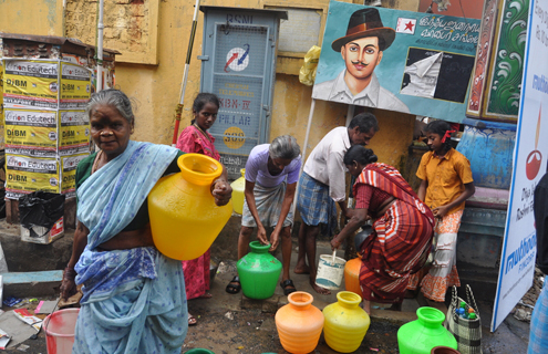 Women collect water in India.