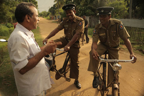 Sri Lankan police patrol on bicycles