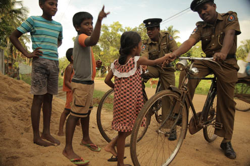 Police patrol on bicycles in Sri Lanka