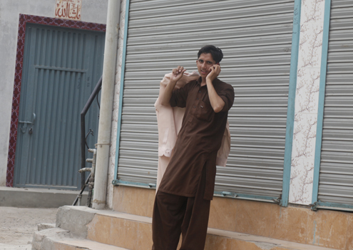 A man speaks on his cell phone in Lahore