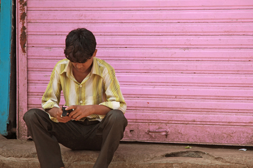 A young man on his phone in India