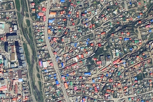 The Selbe River separates a ger area in the Bayanzurkh district and retail development in the Sukhbaatar district.