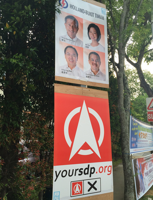 Campaign signs for the PAP and SDP in Singapore. Photo/Flickr user Jack at Wikipedia http://bit.ly/1Vb0qNF