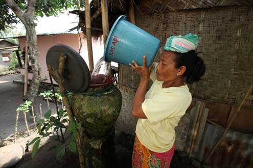 Indonesian woman collects water