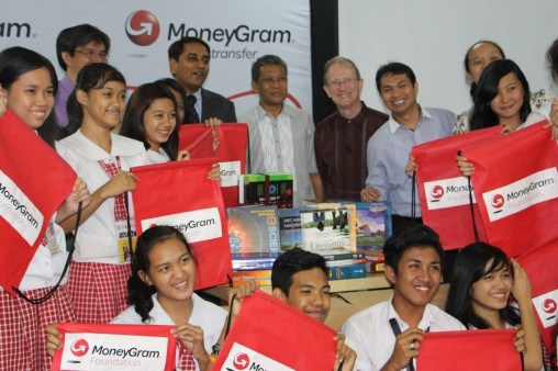 MoneyGram executives and The Asia Foundation's Dr. Steven Rood and Reynald Ocampo distribute books to Rizal High School in Pasig City.